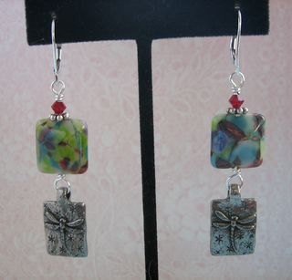 Lampwork and green girl earrings hanging
