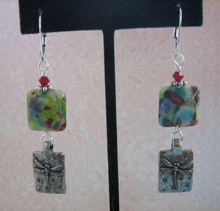Lampwork and green girl earrings hanging