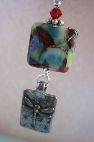 Lampwork and green girl right
