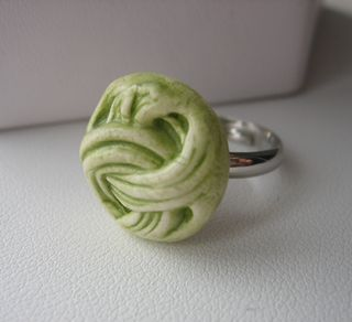 Green criss cross ring
