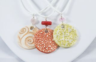 Three Porcelain Pendants
