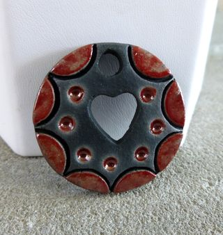 Red heart cutout pendant