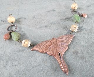 Luna moth necklace front